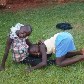 2 Girls Playing on Ground