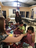 Rev. Nancy, Rachel, & others giving manicures